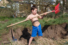 Boy digs a hole Royalty Free Stock Photo