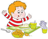 Boy at dinner Stock Photography