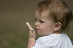Boy with dirty mouth. Little baby boy with really dirty mouth and confused look royalty free stock images