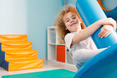 Boy on disc swing. Happy boy using blue disc swing for therapy Royalty Free Stock Photo