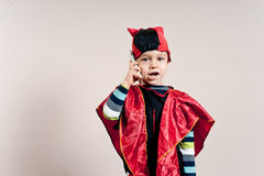Boy in disguise. With the phone Royalty Free Stock Images
