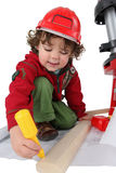 Boy disguised as carpenter Royalty Free Stock Images