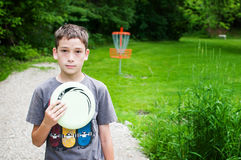 Boy on a disk golf course Royalty Free Stock Photos