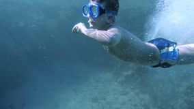 Boy dive in the Red sea with underwater mask