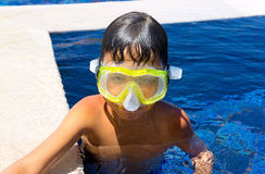 Boy diver in a swimming-pool Stock Photos