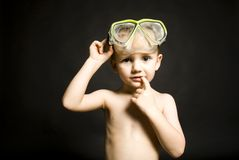 Boy with diving goggles. Portrait of a cute boy with diving goggles Stock Photo