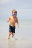 Boy in diving mask on sea background Stock Image