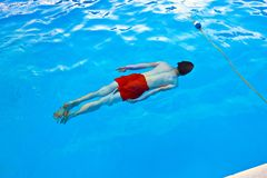 Boy  diving in the pool Royalty Free Stock Image
