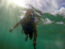 Boy diving snorkeling ocean underwater mask selfie Royalty Free Stock Photography