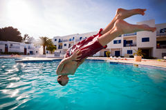 Boy diving in swimming pool Royalty Free Stock Photo