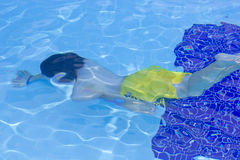 The boy is diving in the swimming pool Stock Photo