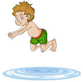 A boy diving into water Stock Image