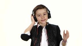 Boy dj wears headphones on head. White background, close ups stock video