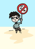 Boy with a do not smoke here sign Royalty Free Stock Photos