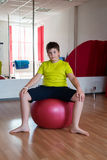 Boy does exercise with the ball Royalty Free Stock Images