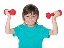 Boy does exercises with dumbbells Stock Photos
