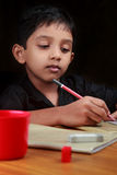 A boy does his homework Stock Image