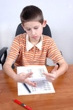 Boy does his math test Royalty Free Stock Image