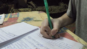 A boy does homework stock video footage