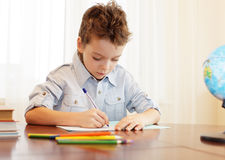 Boy does house lessons Stock Images