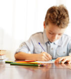 Boy does house lessons Stock Photo