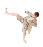 Boy does karate kick Stock Image