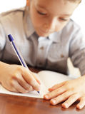Boy does a lesson Royalty Free Stock Photo