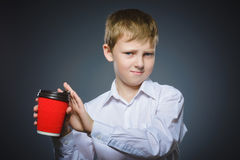 Boy does not want to drink coffee. The child does not like the beverage Royalty Free Stock Photo