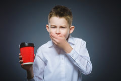 Boy does not want to drink coffee. The child does not like the beverage Royalty Free Stock Images
