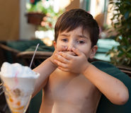 Boy does not want to eat ice cream Royalty Free Stock Images