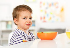 Boy does not want to eat. A small boy crying. Refusing to eat Royalty Free Stock Photos