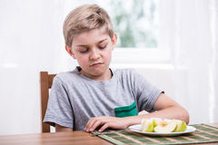 Boy doesn't like fruit Royalty Free Stock Photo