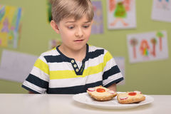 Boy doesn't like his sandwiches Stock Photos