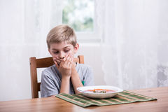 Boy doesn't want to eat Royalty Free Stock Images