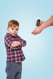 Boy doesn`t want to take medicine from his mother. ?apricious little boy doesn`t want to take medicine from his mother and standing with hands folded isolated on Royalty Free Stock Image