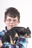 Boy with dog. Boy with glasses with small dog Stock Images