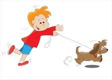 Boy and dog. The boy runs for a dog Stock Photos