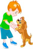 Boy and dog. Red Hair boy playing with cute puppy Royalty Free Stock Photos