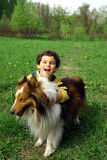 The boy and а dog. Spring walk in a wood. Game with a dog Stock Photography