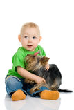 Boy with dog. Photo of the sitting little boy with a dog Royalty Free Stock Photos