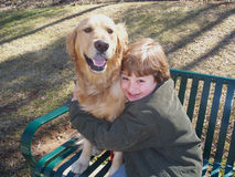 Boy and dog on bench Royalty Free Stock Photography