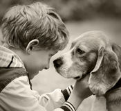 Boy and dog black and white portrait Royalty Free Stock Photo