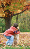 Boy and Dog in the Fall royalty free stock photography