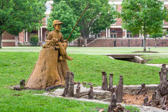 Boy and Dog Fishing Sculpture at Theta Pond Royalty Free Stock Image