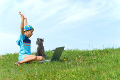 The boy, dog and laptop Stock Images