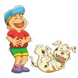 Boy and dog laughing Stock Images