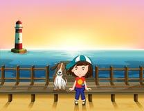 A boy, a dog and a light house Stock Image
