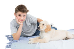 Boy with dog lying on blanket Royalty Free Stock Photography