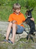 Boy and dog in nature. Royalty Free Stock Image