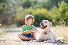 Boy with a dog on the nature Stock Photography